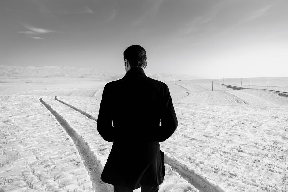 A man that is standing in the snow